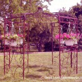 This iron gazebo has an 8 by 8 ft base area