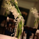 White wedding centerpiece ideas- Riverwalk Clubhouse: Destination Create offers wedding planning, decorating, styling, planning & specialty rentals.