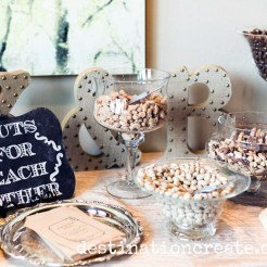A delicious nut bar greets the wedding guests next to the bar... not a bad idea