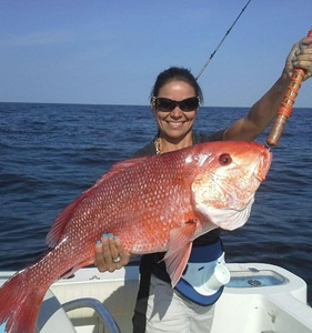 girl holding large snapper