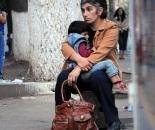 woman sitting street