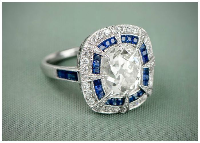 A sapphire and diamond antique engagement ring with a 4 98 carat cushion cut