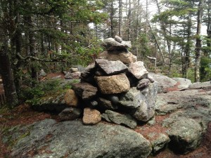 Rock pile that officially establishes the summit at Mount Tecumseh. The camera didn't pick up the buzzing black flies (photo by K. Keyser).