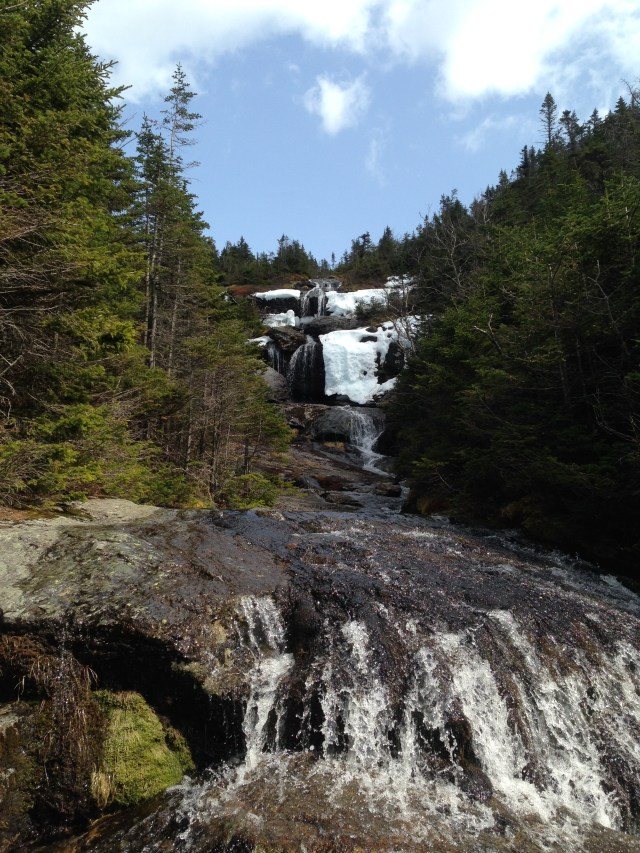 Waterfall with small headwall of snow on the Ammo Trail.
