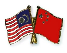 Flag pins: Malaysia and China.