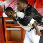 PHOTOS:PASTOR DELIVERS SERMON WHILE RIDING ON THE BACKS OF CONGREGANTS