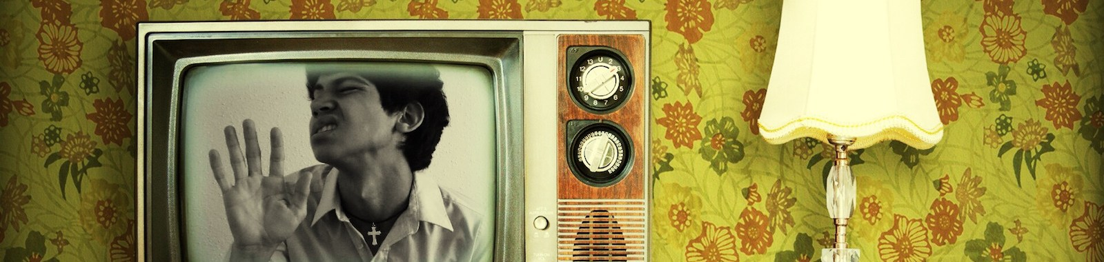 Young Man In Retro Styled Television Set