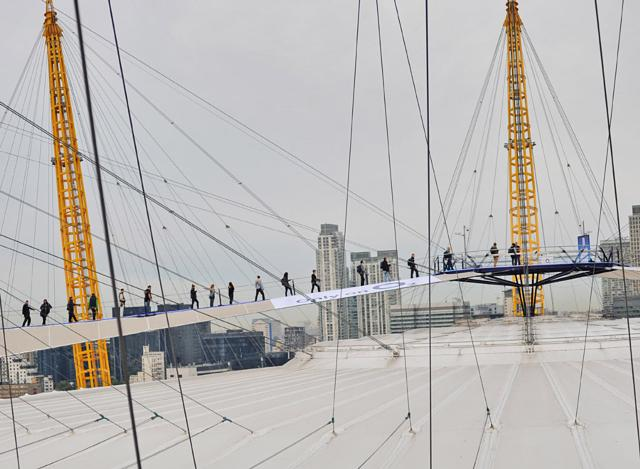 Customers queued from early morning to be one of the first people in the UK to snap up the new iPhone 5 from the top of the iconic London landmark as part of the 'Pop Up Shop at The O2'