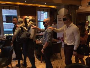 Image of blindfolded guests being led in by host Raheem