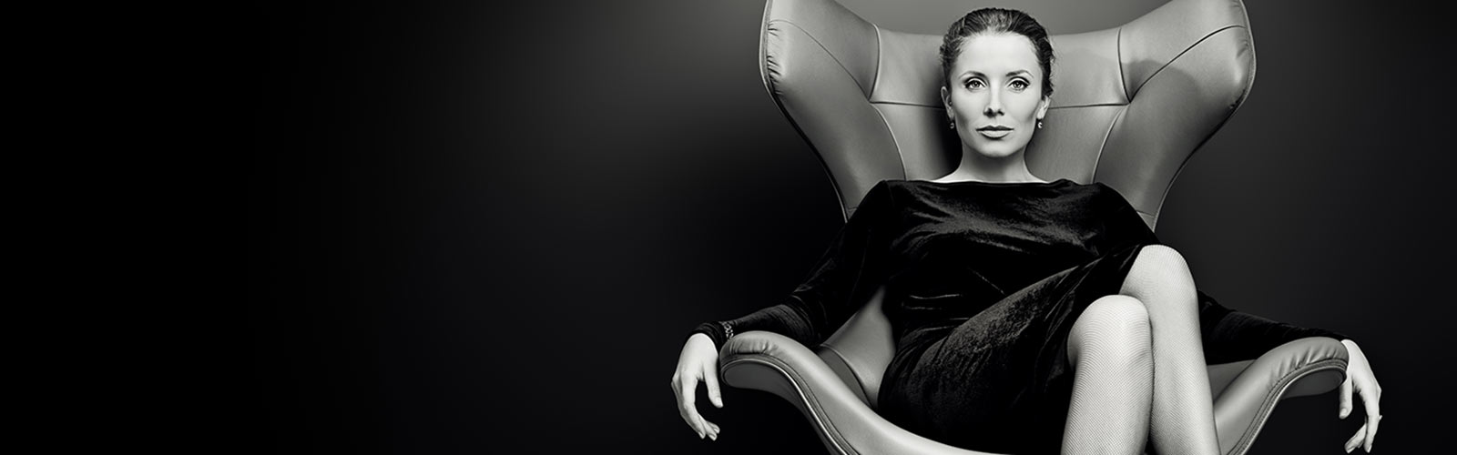 luxury-bW-boss-woman-on-chair-1600x500