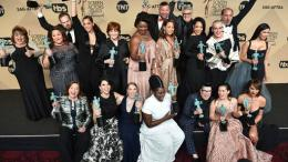 "The cast and crew of ""Orange is the New Black"" pose in the press room with the awards for the award for outstanding performance by an ensemble in a comedy series at the 23rd annual Screen Actors Guild Awards at the Shrine Auditorium & Expo Hall on Sunday, Jan. 29, 2017, in Los Angeles. (AP)"