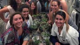 This May 1, 2015 photo provided by Connie Collins shows a group of friends posing for a photo on Galentine's Day as they celebrated by making terrariums, along with participating in a potluck at the home of Macie Skipwith in San Jose, Calif. (AP)