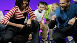 "In this Feb. 9, 2012, file photo, first lady Michelle Obama and Bob Harper of ""The Biggest Loser"" do the Interlude dance during a Let's Move event with children from Iowa schools at the Wells Fargo Arena in Des Moines, Iowa. (AP)"
