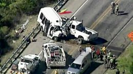 In this aerial image made from a video provided by KABB/WOAI authorities respond to a deadly crash involving a van carrying church members and a pickup truck on U.S. 83 outside Garner State Park in northern Uvalde County, Texas, Wednesday, March 29, 2017. (AP)