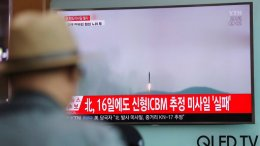 A man watches a TV news program reporting about North Korea's missile firing with a file footage, at Seoul Train Station in Seoul, South Korea, Saturday, April 29, 2017. (AP)