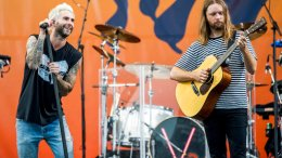 Adam Levine, left, and James Valentine of Maroon 5 perform at the New Orleans Jazz and Heritage Festival on Saturday, April 29, 2017, in New Orleans. (AP)