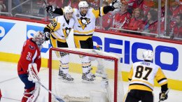 Pittsburgh Penguins right wing Phil Kessel (81) celebrates his goal with center Jake Guentzel (59) and Sidney Crosby (87) during the third period of Game 2 in an NHL hockey Stanley Cup second-round playoff series against Washington Capitals goalie Philipp Grubauer (31), of Germany, Saturday, April 29, 2017, in Washington. (AP)