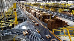 In this Aug. 3, 2017, photo, packages ride on a conveyor system at an Amazon fulfillment center in Baltimore. (AP)