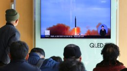 People watch a TV screen showing file footage of North Korea's missile launch at Seoul Railway Station in Seoul, South Korea, Tuesday, Nov. 21, 2017. (AP)