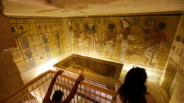 In this Thursday, Nov. 5, 2015, file photo, tourists look at the tomb of King Tut as it is displayed in a glass case at the Valley of the Kings in Luxor. (AP)