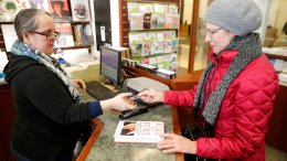 "Rebecca Burgess (left) sells a copy of the book ""Fire and Fury: Inside the Trump White House"" by Michael Wolff to Susan Vander Veer,  from Peotone, Ill., at Barbara's Books Store, Friday, Jan. 5, 2018, in Chicago. (AP)"