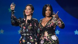 Host Olivia Munn (left) and Niecy Nash speak at the 23rd annual Critics' Choice Awards at the Barker Hangar on Thursday, Jan. 11, 2018, in Santa Monica, Calif. (AP)
