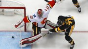 Pittsburgh Penguins' Evgeni Malkin (71) gathers the puck and prepares to put it behind Calgary Flames goaltender Jon Gillies (32) for a goal in the first period of an NHL hockey game in Pittsburgh, Monday, March 5, 2018. (AP)