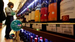 In this Jan. 30, 2011, file photo, wine imported from the U.S. is displayed at a supermarket in Beijing. China announced a list of U.S. goods including pork, apples and steel pipe on Friday, March 23, 2018, that it said may be hit with higher import duties in response to President Donald Trump's tariff hike on steel and aluminum. (AP)