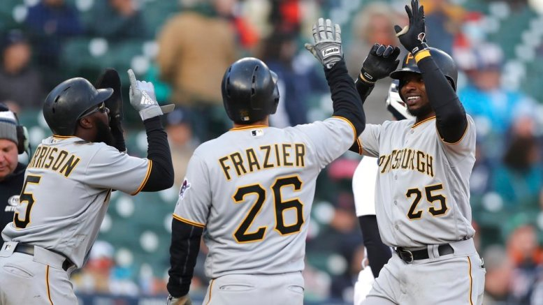 Pittsburgh Pirates' Gregory Polanco is greeted by teammates Adam Frazier (26) and Josh Harrison after they scored on Polanco's three-run home run during the 13th inning of a baseball game against the Detroit Tigers, Friday, March 30, 2018, in Detroit. (AP)