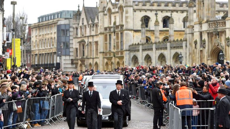 The hearse containing Professor Stephen Hawking arrives at University Church of St Mary the Great as mourners gather to pay their respects, in Cambridge, England, Saturday March 31, 2018. (AP)