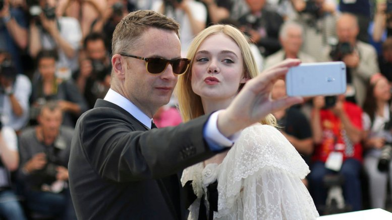 In this May 20, 2016 file photo, director Nicolas Winding Refn and actress Elle Fanning pose for a selfie photograph during a photo call for the film The Neon Demon at the 69th international film festival, Cannes, southern France. (AP)