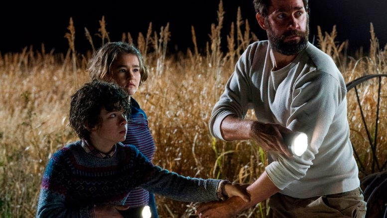 """This image released by Paramount Pictures shows Noah Jupe (from left), Millicent Simmonds and John Krasinski in a scene from """"A Quiet Place.""""  (AP)"""
