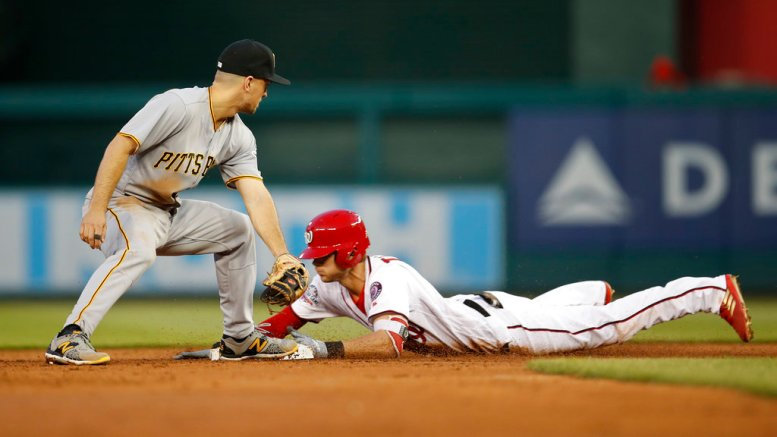 Washington Nationals' Trea Turner slides safely into second ahead of the tag by Pittsburgh Pirates second baseman Adam Frazier (26) after hitting a double in the third inning of a baseball game at Nationals Park, Monday, April 30, 2018, in Washington. (AP)