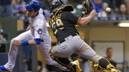 Milwaukee Brewers' Christian Yelich avoids the tag of Pittsburgh Pirates' Francisco Cervelli to score during the sixth inning of a baseball game Friday, May 4, 2018, in Milwaukee. (AP)