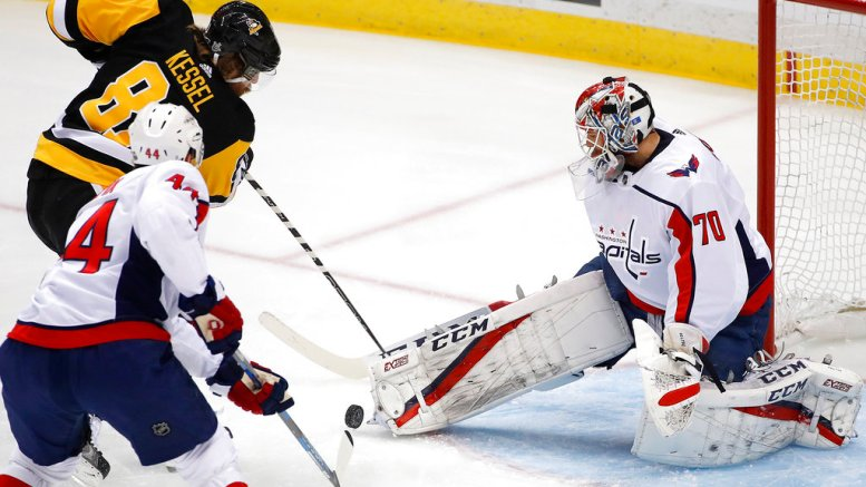 Washington Capitals goaltender Braden Holtby (70) stops a shot by Pittsburgh Penguins' Phil Kessel (81) during the first period in Game 6 of an NHL second-round hockey playoff series in Pittsburgh, Monday, May 7, 2018. (AP)