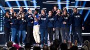 """Khalid (seventh from left) and Shawn Mendes (fifth from right) perform """"Youth"""" with the Stoneman Douglas choir, of the Marjory Stoneman Douglas High School, at the Billboard Music Awards at the MGM Grand Garden Arena on Sunday, May 20, 2018, in Las Vegas. (AP)"""