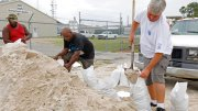 Gulfport, Miss., residents shovel sand into bags at a Harrison County Road Department sand bagging location, while preparing for Subtropical Storm Alberto to make its way through the Gulf of Mexico, Saturday, May 26, 2018. (AP)