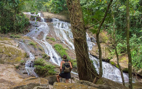 tourist hiking in belize on ecotourism trip