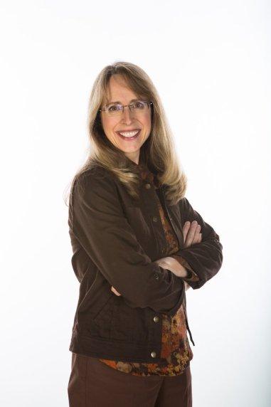 Jane Birch in brown