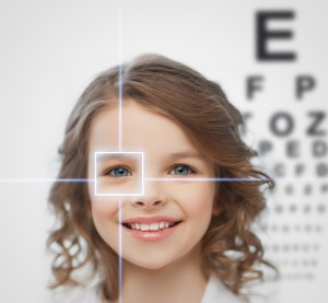 Girl with eye chart-common pediatric eye diseases