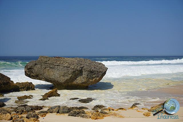 big rock in beach pacitan