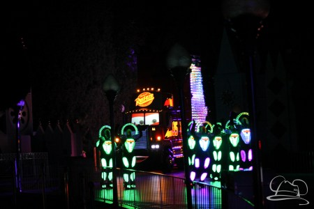 Mack Truck is joined by dancers in Disneyland's Paint the Night Parade.
