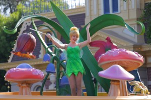 Tinker Bell rides high above Peter Pan in Mickey's Soundsational Parade.