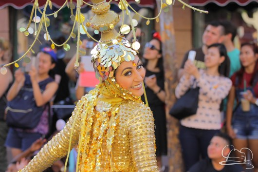 Prince Ali's coin dancer makes her way down Disneyland's parade route in Mickey's Soundsational Parade.