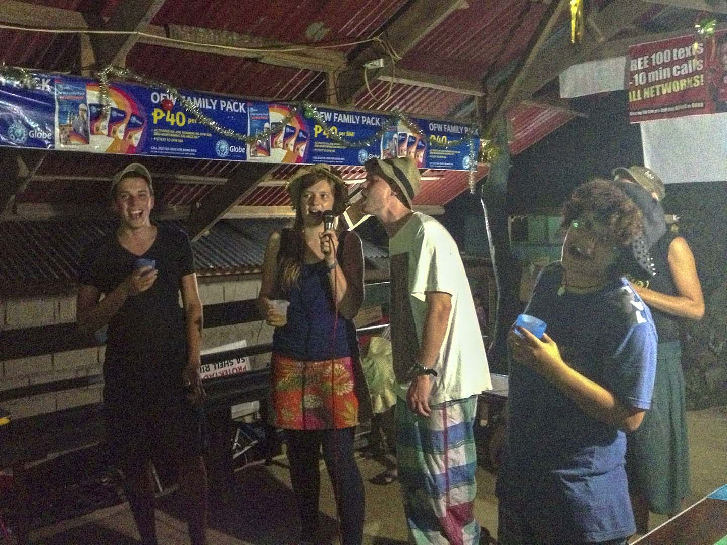 Foreign volunteers singing karaoke at the village 酒吧