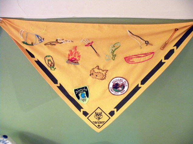 "Used Sublime Stitching's ""Camp Out"" patterns (and some of my old scout badges) to add flair to this kerchief for my son's Scout-themed nursery"