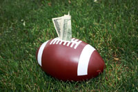 Football with money coming out