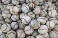 Many baseballs representing How Many Colleges to Target to Play College Baseball