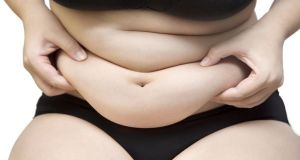 Woman squeeze belly fat wearing black underwear bra and pant on