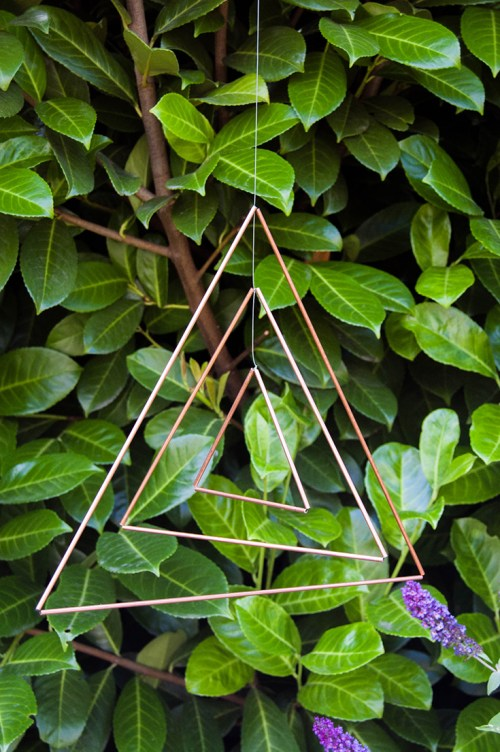 Make a copper triangle mobile, then hang it either indoors or outside.